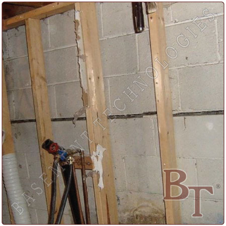 Cinder block foundation bowed wall repair galleries and for Concrete block basement walls